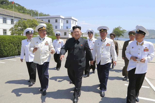 North Korean leader Kim Jong Un (C) smiles during his inspection of the Korean People's Army (KPA) Naval Unit 167 in this undated photo released by North Korea's Korean Central News Agency (KCNA) in Pyongyang June 16, 2014. (Photo by Reuters/KCNA)