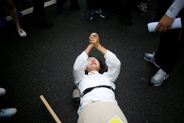 A Christian woman who opposes homosexuality tries to stop a march during the Korea Queer Culture Festival 2016 in central Seoul, South Korea, June 11, 2016. (Photo by Kim Hong-Ji/Reuters)