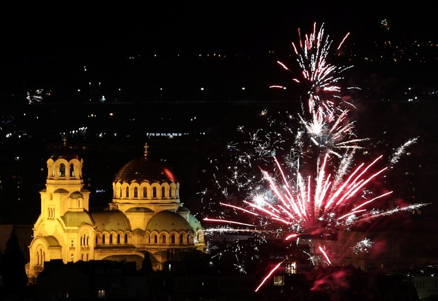 Fireworks explode over Alexander Nevski cathedral during the New Year celebrations in Sofia, Bulgaria on January 1, 2020. (Photo by Stoyan Nenov/Reuters)