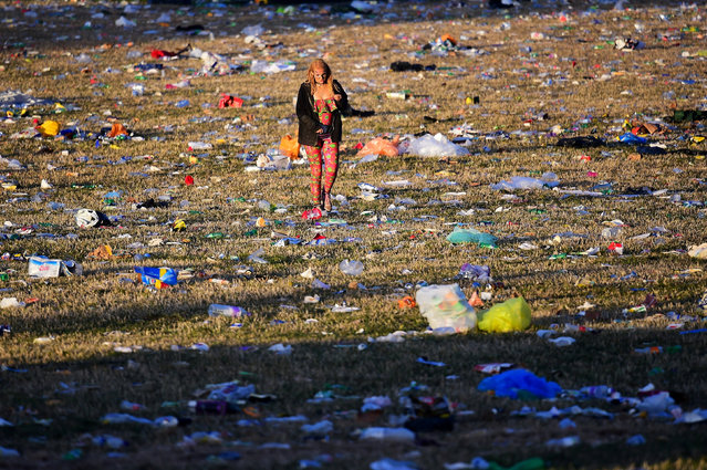 Revellers and detritus are seen near the Pyramid Stage at Worthy Farm in Somerset during the Glastonbury Festival in Britain, June 26, 2017. (Photo by Dylan Martinez/Reuters)
