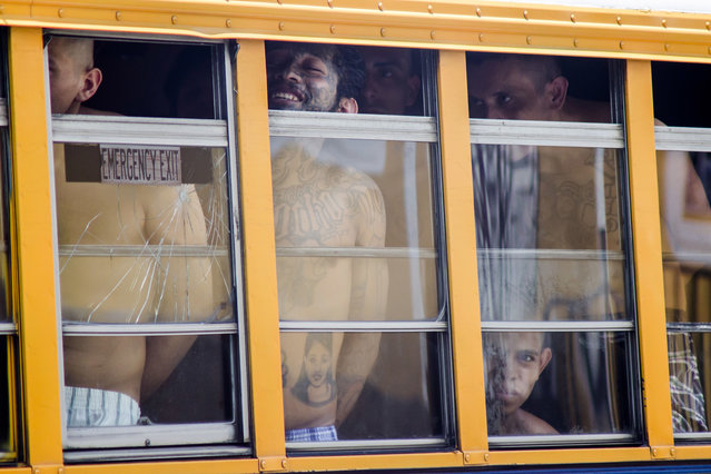 Inmates ride in a bus out of the Cojutepeque prison in El Salvador, Thursday, June 16, 2016. This prison, which houses more than a thousand 18th street imprisoned gang members, will be closed down by the government, since it has been unable to prevent the amount of illegal activities happening inside the prison walls. Inmates will be relocated to other medium-security prisons. (Photo by Salvador Melendez/AP Photo)
