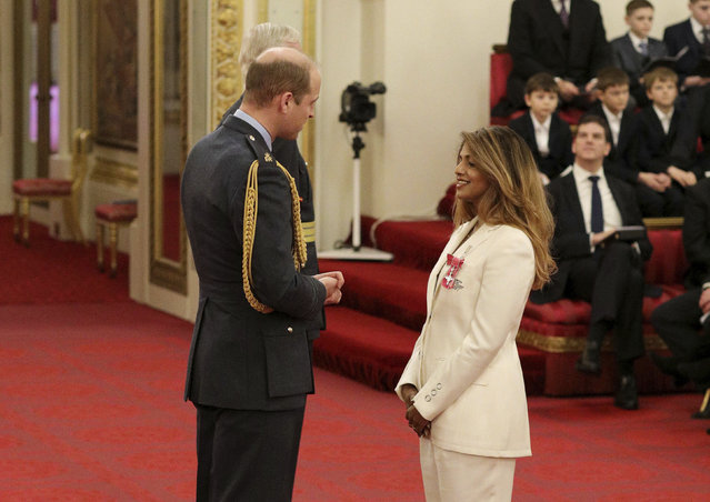 Rapper and singer MIA, real name Mathangi Arulpragasam, is made an MBE by Prince William Duke of Cambridge, left, at Buckingham Palace, in London, Tuesday January 14, 2020. The honorary award is conferred in recognition of contributions to the arts, sport, sciences, and charitable works. (Photo by Jonathan Brady/PA Wire via AP Photo)
