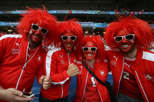 Switzerland supporters pose before the  Euro 2016 group A football match between Switzerland and France at the Pierre-Mauroy stadium in Lille on June 19, 2016. (Photo by Kenzo Tribouillard/AFP Photo)