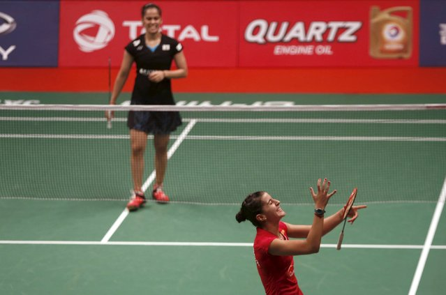 Spain's Carolina Marin (R) reacts after beating India's Saina Nehwal during their  women's finals badminton match at the BWF World Championships in Jakarta, August 16, 2015. (Photo by Reuters/Beawiharta)