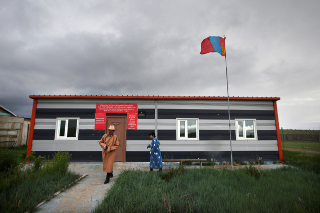 Villagers leave a polling station after voting for the parliamentary elections on the outskirt of Ulaanbaatar, Mongolia, June 29, 2016. (Photo by Jason Lee/Reuters)
