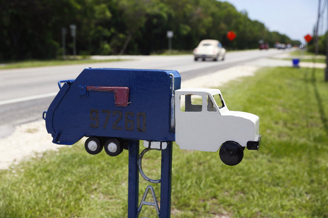 A mailbox in the shape of a truck is seen along the highway US-1 in the Lower Keys near Key Largo in Florida, July 10, 2014. (Photo by Wolfgang Rattay/Reuters)