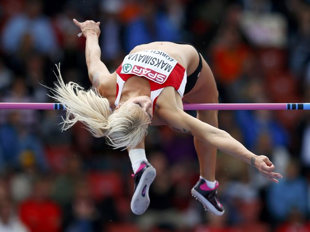 Jana Maksimava of Belarus competes in the high jump event of women's heptathlon during the European Athletics Championships at the Letzigrund Stadium in Zurich August 14, 2014. (Photo by Phil Noble/Reuters)