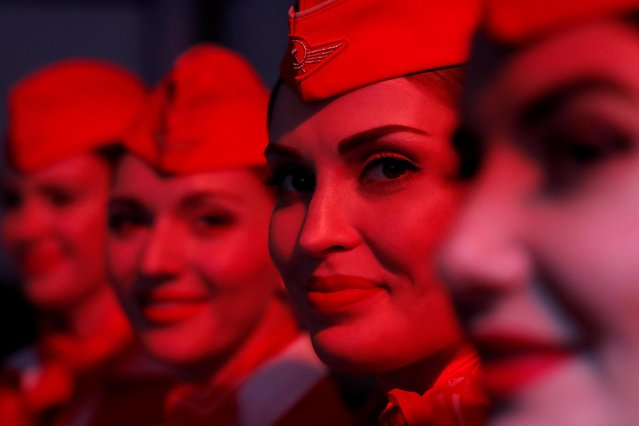 Stewardesses pose for a picture before a presentation ceremony for the first Airbus A350-900 aircraft of Aeroflot at Sheremetyevo International Airport outside Moscow, Russia on March 4, 2020. (Photo by Maxim Shemetov/Reuters)