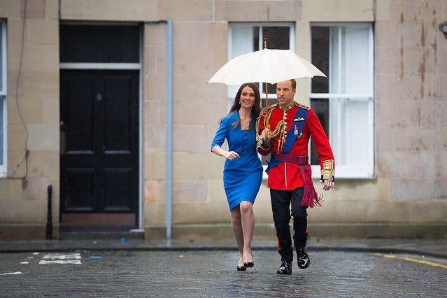 """""""The Duke and Duchess of Cambridge"""" outside the Summerhall arts venue in Edinburgh, Scotland, where their creator Alison Jackson is holding a live performance of her work called La Trashiata. (Photo by James Glossop/The Times/SIPA Press/News Syndication)"""