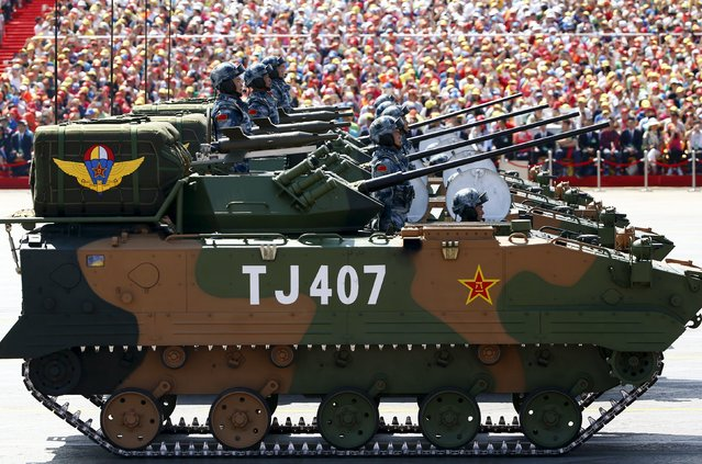 Soldiers of China's People's Liberation Army (PLA) stand on armored vehicles during the military parade marking the 70th anniversary of the end of World War Two, in Beijing, China, September 3, 2015. (Photo by Damir Sagolj/Reuters)