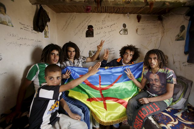 Activists sit in a makeshift house at a hilltop above a silver mine, where they have been holding a permanent sit-in since 2011, near the town of Imider, southeastern Morocco, August 30, 2015. Three kilometers from Imider, dozens of poor and unemployed young villagers have been holding a permanent sit-in since 2011. (Photo by Youssef Boudlal/Reuters)