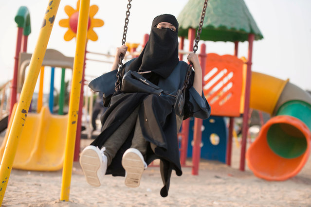 A Saudi woman swings at a park in Jeddah, Saudi Arabia, October 3, 2017. (Photo by Reem Baeshen/Reuters)