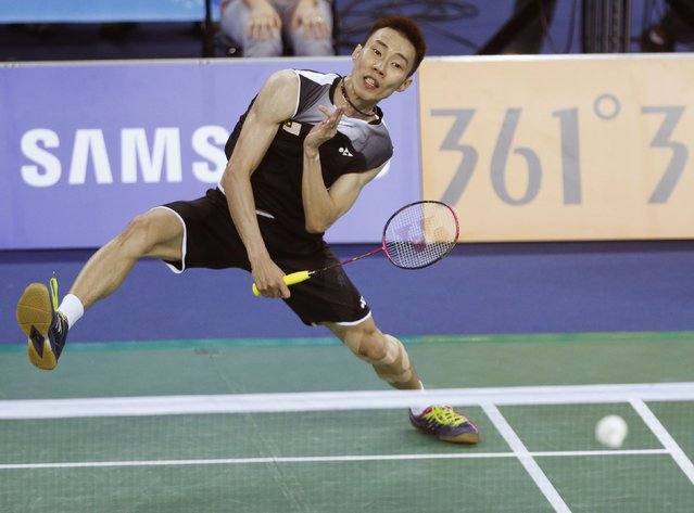 Malaysia's Lee Chong Wei returns a shot by China's Chen Long during their men's singles semi-finals badminton match at the Gyeyang Gymnasium during the 17th Asian Games in Incheon September 22, 2014. (Photo by Olivia Harris/Reuters)