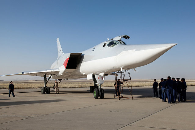 In this photo taken on Monday, Aug. 15, 2016, A Russian Tu-22M3 bomber stands on the tarmac at an air base near Hamedan, Iran. Russian warplanes took off on Tuesday August 16, from Iran to target Islamic State fighters and other militants in Syria, widening Moscow's bombing campaign in Syria.(Photo by WarfareWW Photo via AP Photo)