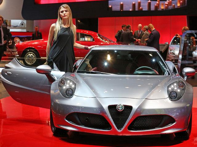 An Alfa Romeo 4C is presented at the Paris Motor Show, in Paris, Thursday October 2, 2014. (Photo by Remy de la Mauviniere/AP Photo)