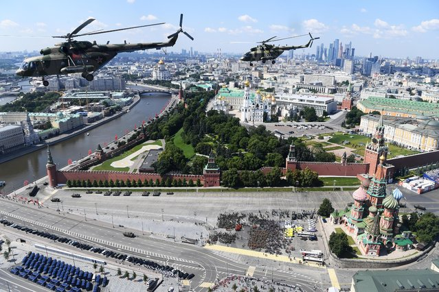 Russian Mi-8 military helicopters fly in formation over Red Square during the Victory Day Parade in Moscow, Russia, June 24, 2020. (Photo by Alexey Maishev/Host Photo Agency via Reuters)