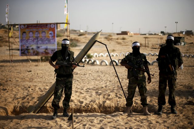 Palestinian militants from al-Husine brigade loyal to Fatah movement, guard a home-made rocket during a military-style exercise graduation ceremony in Khan Younis in the southern Gaza Strip, September 20, 2015. (Photo by Suhaib Salem/Reuters)