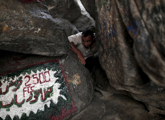 A Muslim pilgrim makes his way to Hera cave, where Muslims believe Prophet Mohammad received the first words of the Koran through Gabriel, at the top of Mount Al-Noor during the annual haj pilgrimage in the holy city of Mecca, September 21, 2015. (Photo by Ahmad Masood/Reuters)