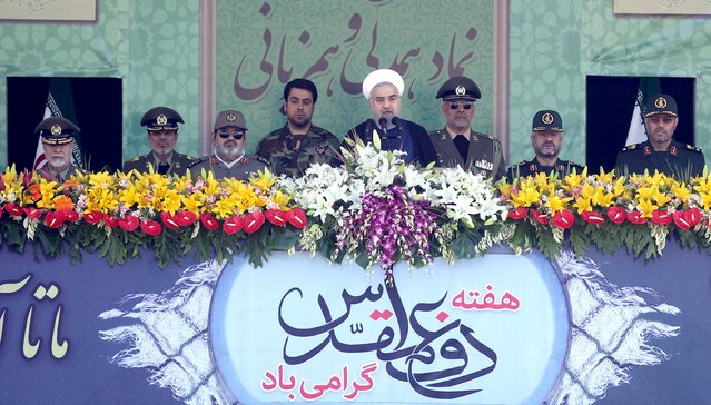 Iranian President Hassan Rouhani (C) delivers a speech as military commanders attend a parade marking the anniversary of the Iran-Iraq war (1980-88), in Tehran September 22, 2015. (Photo by Raheb Homavandi/Reuters/TIMA)