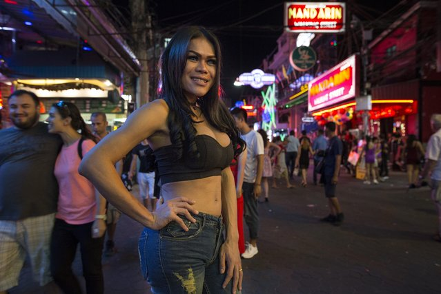 A Ladyboy is seen along the Walking Street where bars and s*x scenes are a commonplace July 31, 2016 in Pattaya, Thailand. (Photo by Paula Bronstein/Getty Images)