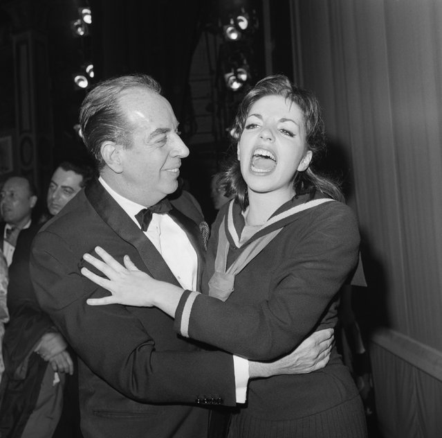 Thrilled with the excitement of opening night on Broadway, singer-actress Liza Minnelli shares the happy moment with her father Vincente Minnelli after the opening of Flora, the Red Menace, in which Miss Minnelli plays the title role in New York on May 13, 1965. The musical, directed by George Abbott and produced by Harold Prince, marks the Broadway debut of Liza, who is the daughter of Judy Garland. Opening night a the Alvin Theatre attracted a host of celebrities, including Senator Jacobs Javits and Representative John Lindsay. (Photo by Bettmann Archive via Getty Images)