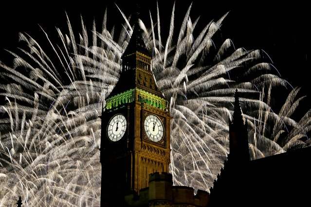 Fireworks explode over Elizabeth Tower in London. (Photo by Kirsty Wigglesworth/Associated Press)