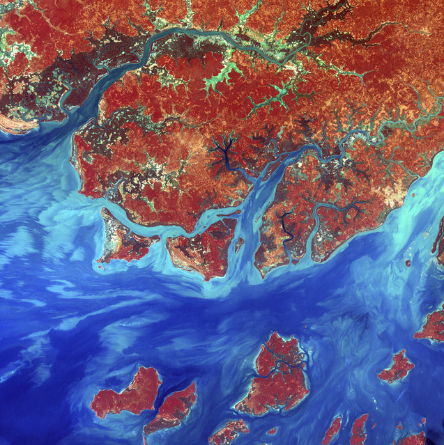 Guinea-Bissau. Guinea-Bissau is a small country in West Africa. Complex patterns can be seen in the shallow waters along its coastline, where silt carried by the Geba and other rivers washes out into the Atlantic Ocean. This is a false-color composite image made using infrared, red and blue wavelengths to bring out details in the silt. Image taken December 1st, 2000, by Landsat 7. (Photo by NASA/GSFC/USGS EROS Data Center)