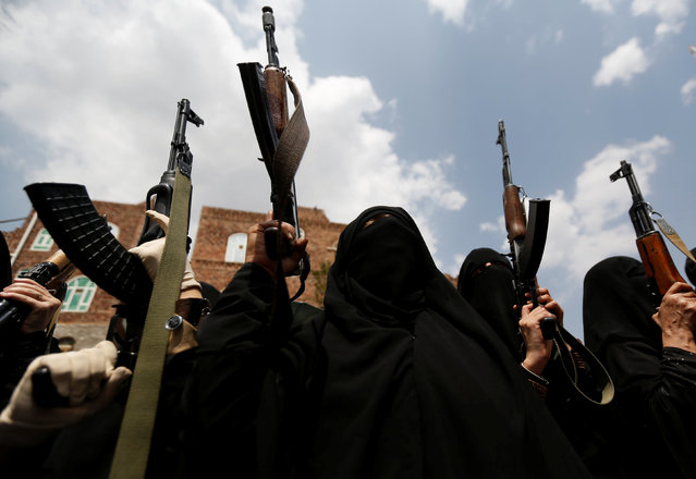 Armed women loyal to the Houthi movement hold up rifles as they take part in a parade to show support to the movement in Sanaa, Yemen September 6, 2016. (Photo by Khaled Abdullah/Reuters)