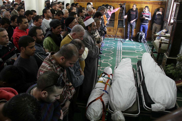 Egyptians say funeral prayers in a mosque for three people who died in demonstrations marking the second anniversary of the January, 25, 2011, Egyptian revolution in Suez, Egypt, on January 26, 2013. (Photo by Ahmed Abd El-Latef/Shorouk Newspaper/AP Photo/The Atlantic)