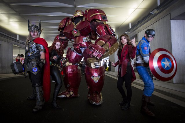 People dressed as (L-R) Thor, Black Widow, Hulkbuster, Scarlet Witch and Captain America pose for photos on day two of New York Comic Con in Manhattan, New York, October 9, 2015. (Photo by Andrew Kelly/Reuters)