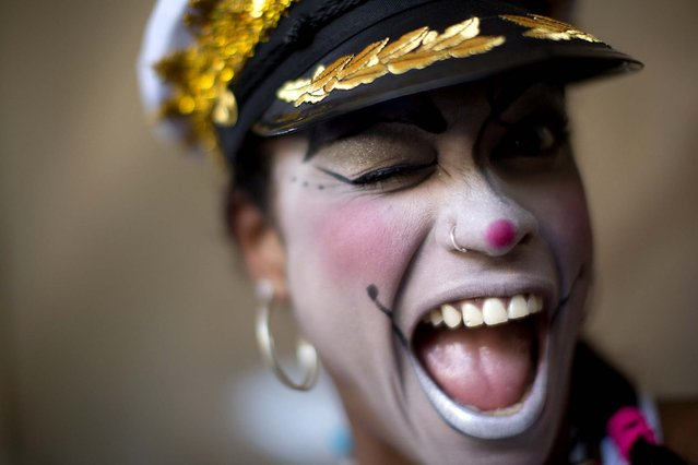 "A woman participates in the ""Carnaval na Central"" block party in Rio. (Photo by Felipe Dana/Associated Press)"