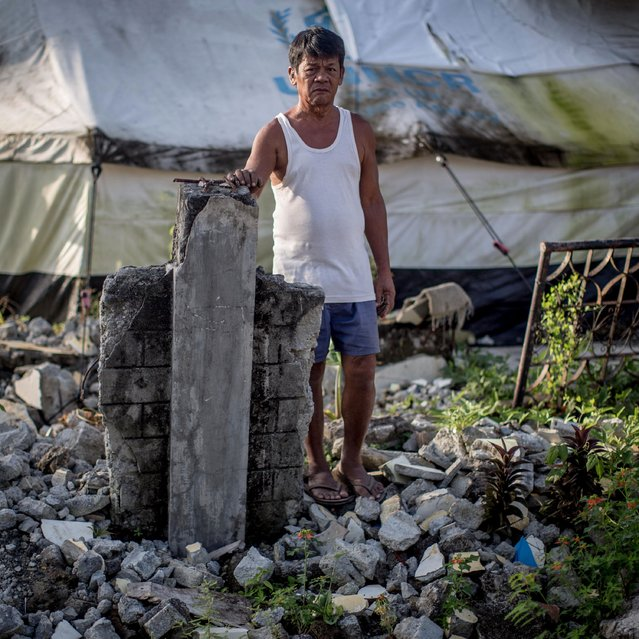 Typhoon Haiyan survivor Carlos Silvano stands amongst the ruins of his home on November 6, 2014 in San Antonio, Samar, Philippines. Carlos has been unable to rebuild is home as it is now in the No Build Zone and he is unable to move to a new location as he does not own a land elsewhere. (Photo by Chris McGrath/Getty Images)