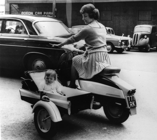 A new design from the makers of Lambretta Scooters, 9th May 1963. Anita White of Teddington rides a power-driven pram with her daughter, Anita.  (Photo by Keystone)