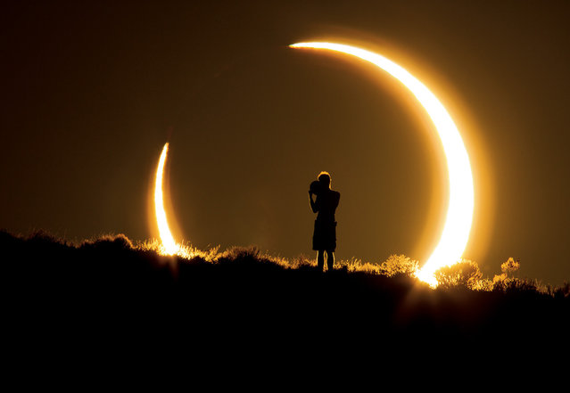 """An Onlooker Witnesses the Annular Solar Eclipse as the Sun Sets on May 20, 2012"". Photo by Colleen Pinski (Peyton, CO). Photographed in Albuquerque, NM, May 2012."