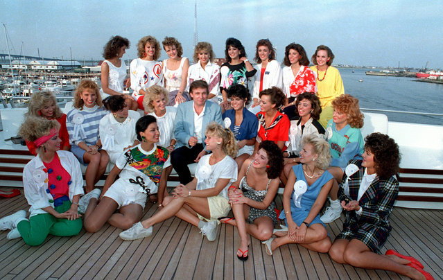 Developer Donald Trump poses with about half of the competing State Misses on board his yacht in Atlantic City, N.J., September 4, 1988. (Photo by Jack Kanthal/AP Photo)