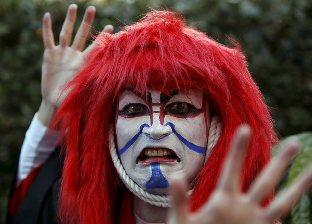 A participant in costume poses for a picture after a Halloween parade in Kawasaki, south of Tokyo, October 25, 2015. (Photo by Yuya Shino/Reuters)