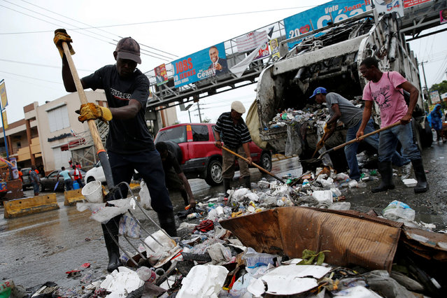 Workers collect the garbage in the street while Hurricane Matthew approaches in Port-au-Prince, Haiti October 3, 2016. (Photo by Carlos Garcia Rawlins/Reuters)