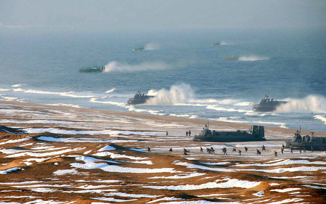 """Excessive digital alteration"" used in official photo showing North Korean Army landing drills on March 26, 2013. Photos had additional ships added to depict more intimidating military presence. The Korean Central News Agency (KCNA) released a photo Tuesday of hovercrafts carrying marines to storm a beach. The Agence France-Presse (AFP), along with other news agencies, published the image but later pulled it due to ""excessive digital alteration"". (Photo by AFP Photo/KCNA)"