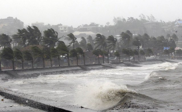 Strong winds and waves brought by Typhoon Hagupit pound the seawall in Legazpi City, Albay province southern Luzon December 7, 2014. The powerful typhoon tore through the central Philippines on Sunday, bringing howling winds that toppled trees and power and cut off communications in areas where thousands were killed by a massive storm just over a year ago. (Photo by Reuters/Stringer)