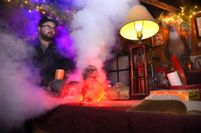 Carroll Moore, co-owner of Death Yard Haunted Attraction, prepares the set where Zombie Santas are featured in Hendersonville, Tennessee December 10, 2014. (Photo by Harrison McClary/Reuters)