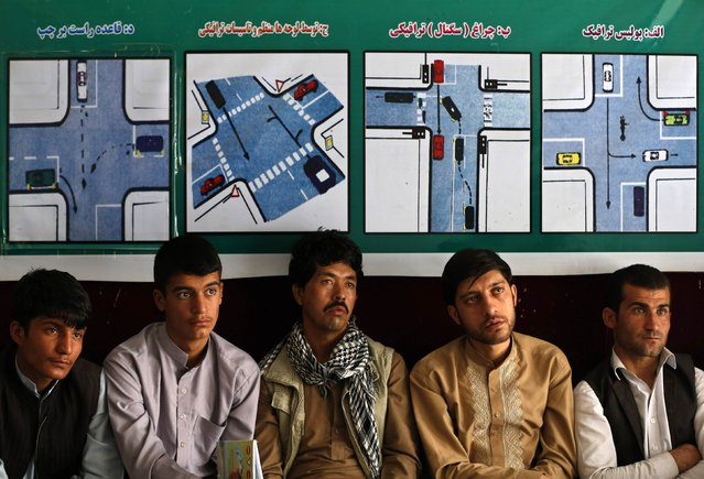 Afghan men attend a class at a driving school in Kabul August 16, 2014. (Photo by Mohammad Ismail/Reuters)