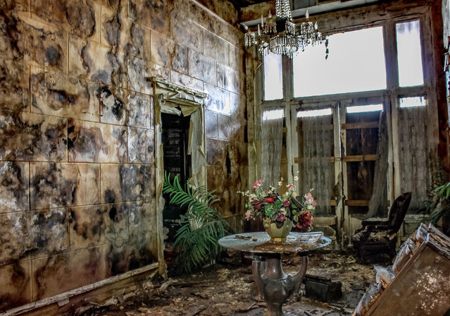 The funeral home is now a death trap, with the roof capable of falling in at any moment and floorboards so rotten that any visitor could easily fall through. This photo was taken last month. (Photo by Abandoned Southeast/Caters News Agency)