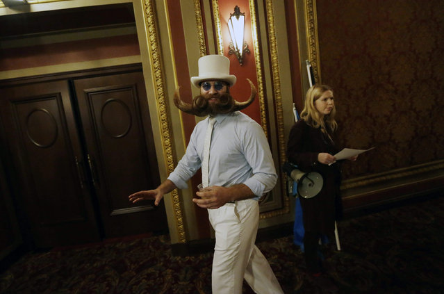 Contestant Adam Gazda walks backstage at the National Beard & Moustache Championships at Kings Theatre in Brooklyn, New York, USA, 07 November 2015. (Photo by Peter Foley/EPA)