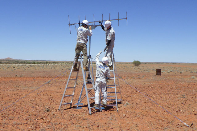 In this photo provided by JAXA, its crew members set up antenna in the preparation for the operation for the capsule collection in Woomera, South Australia in November, 2020. The Hayabusa2 spacecraft left the asteroid Ryugu, about 300 million kilometers (180 million miles) from Earth, a year ago and is expected to reach Earth and drop a capsule containing the precious samples in southern Australia on Dec. 6. (Photo by JAXA via AP Photo)