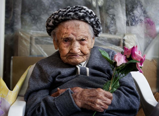 Amalia Lopez, who is 114-years-old, poses for a portrait inside her home on Mother's Day in Mexico City, on May 10, 2013. Lopez was honored by the city for being the oldest living woman in Mexico City. Lopez has survived her four children, and has 15 grandchildren and three great-grandchildren. Lopez was born on July 10, 1898, and will turn 115 this July 10. (Photo by Eduardo Verdugo/Associated Press)