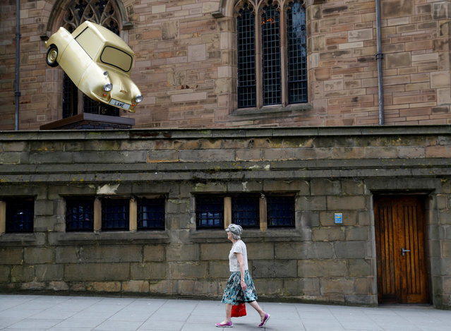 "A woman walks past ""Gold Lamé"" an installation by disabled artist Tony Heaton, in Liverpool, Britain, June 12, 2018. (Photo by Phil Noble/Reuters)"