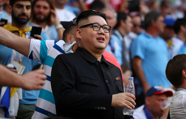 A fan impersonating North Korean leader Kim Jong Un in the stands during the Russia 2018 World Cup Group A football match between Uruguay and Russia at the Samara Arena in Samara on June 25, 2018. (Photo by Michael Dalder/Reuters)