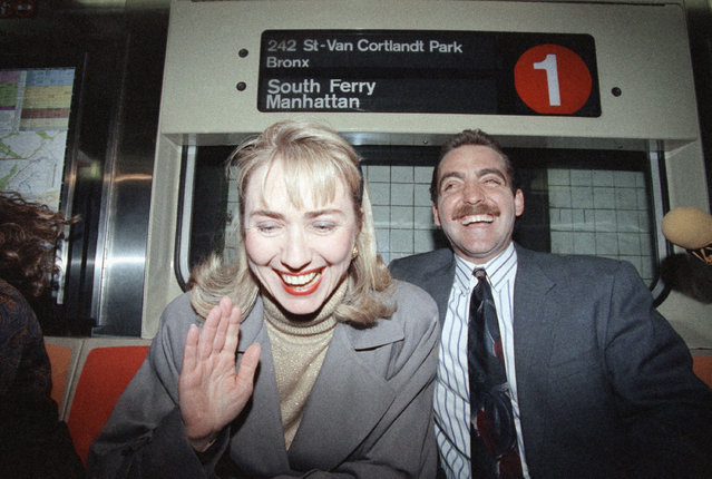 Hillary Rodham Clinton, wife of Democratic presidential hopeful Gov. Bill Clinton of Arkansas, shares a laugh with Scott Stillman of Queens, New York, March 30, 1992, as they ride the New York City subway. Clinton, campaigning for her husband, was en route to New York University where she delivered a speech to law students. (Photo by Alex Brandon/AP Photo)