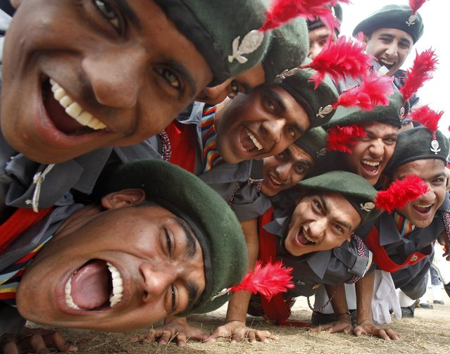 Cadets from the National Cadet Corps (NCC) celebrate after being awarded the first position in the best marching trophy competition during the Republic Day celebrations in the northern Indian city of Chandigarh January 26, 2015. (Photo by Ajay Verma/Reuters)