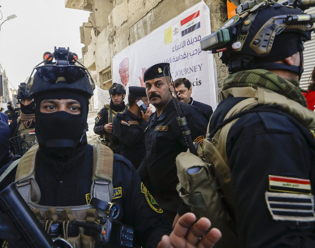 Iraqi security forces deploy in Mosul, northern Iraq, once the de-facto capital of IS, where Pope Francis will pray for the victims of war at Hosh al-Bieaa Church Square, Sunday, March 7, 2021. The long 2014-2017 war to drive IS out left ransacked homes and charred or pulverized buildings around the north of Iraq, all sites Francis will visit on Sunday. (Photo by Andrew Medichini/AP Photo)